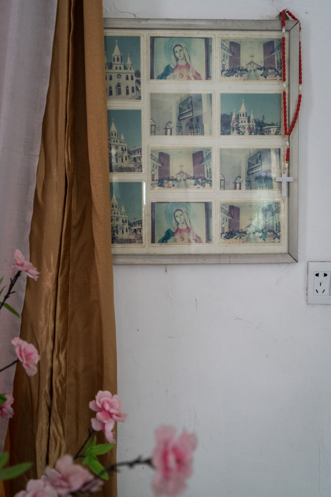 Old photos of Bobei Catholic Church are framed and hung inside the church in Guangdong province, China on March 4, 2018.