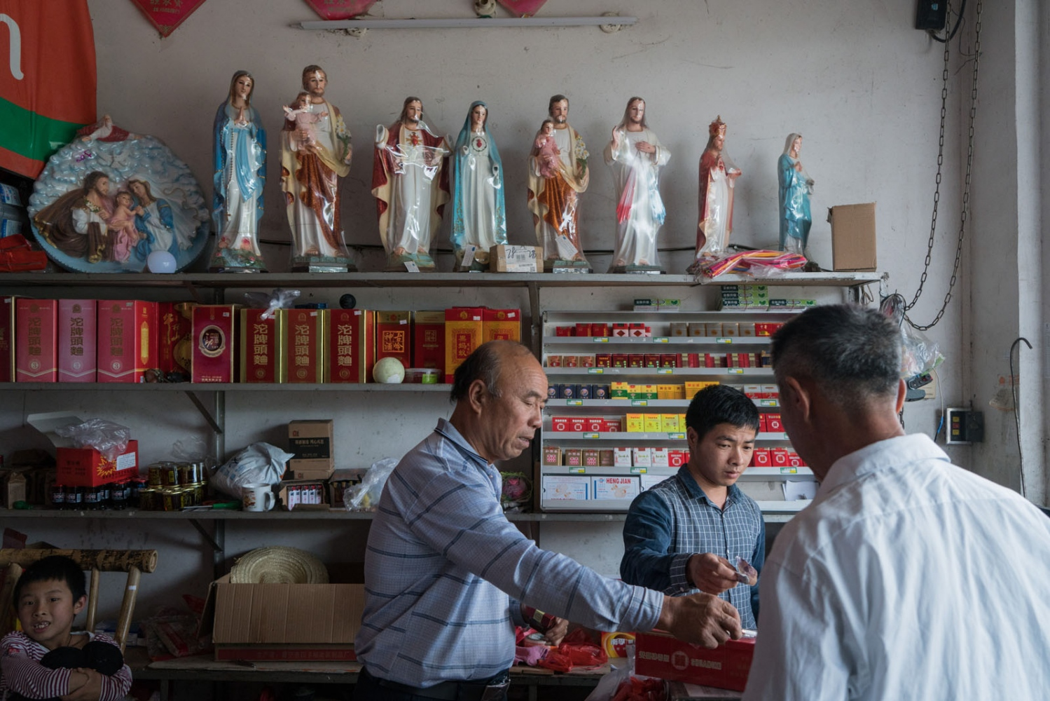 Small Catholic statues are on the shelf of a shop in Bobei village, in Guangdong province, China on March 4, 2018. About 800 people in the local community are Catholic.