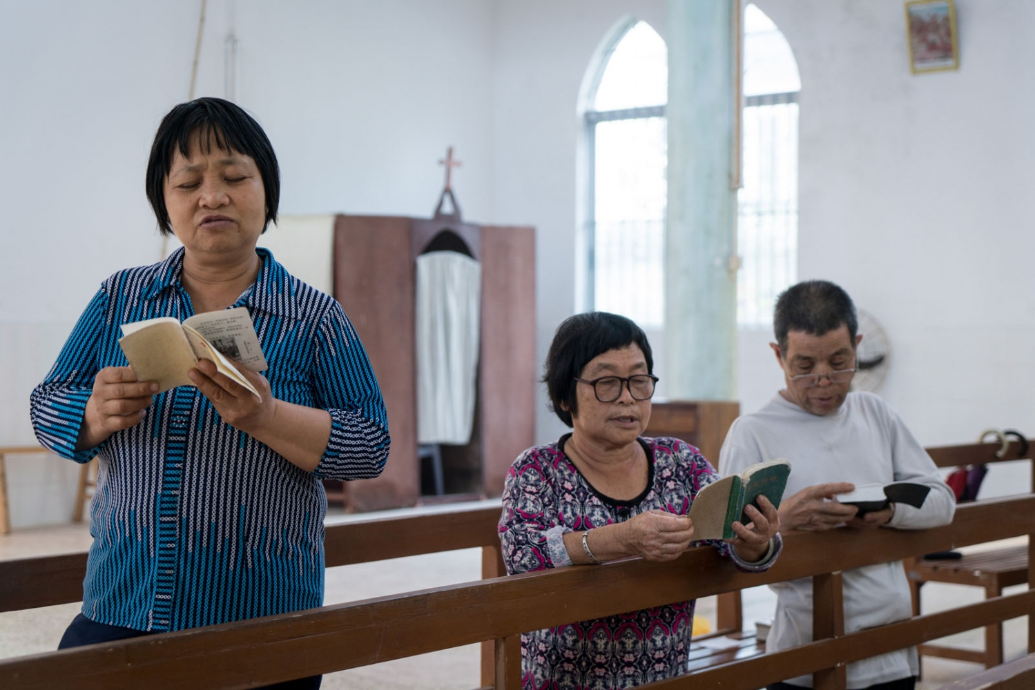 Catholics from nearby villages pray and chant in Luotianba Church in Guangdong province, China on the afternoon of March 4, 2018.
