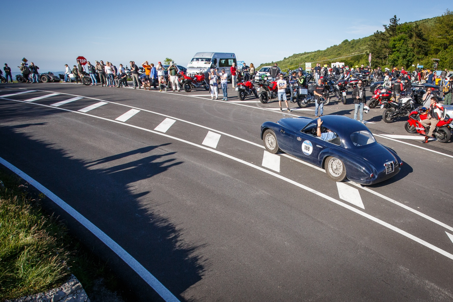 1000 Miglia historic road race Alfa Romeo 6C 2500 SS coup touring pass on the road of the Raticosa Pass towards Bologna