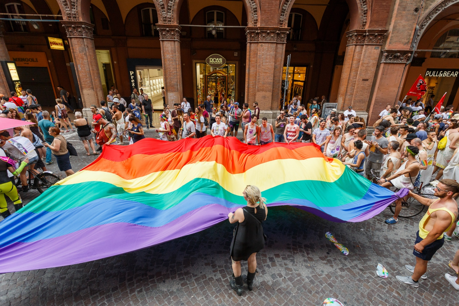 The LGBT Pride in Bologna Marchers walk with a giant rainbow flag as the LGBT community celebrates Pride in Bologna on June 25, 2016 in Bologna, Italy. The parade is part of a World Pride Week and attracted thousands of marchers fighting for gay rights. 2016 Pride comes just two weeks after Omar Mateen shot dead 50 people at Pulse, a gay nightclub in Orlando, Florida.