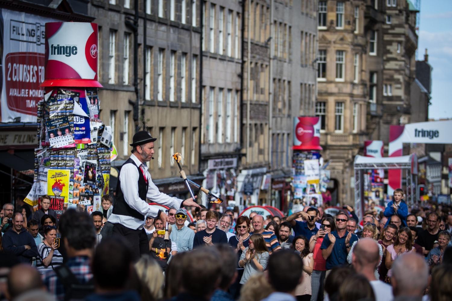 The 2016 Edinburgh Festival Fringe An Edinburgh Festival Fringe entertainer performs on the Royal Mile.