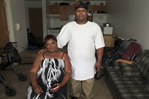 Grace Griffin, left, poses with her son at their new apartment in Detroit, Mich.