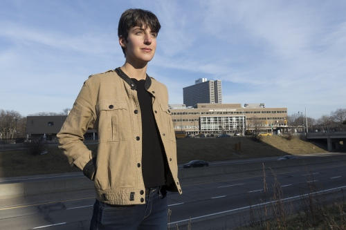 Emily Kutil poses for a portrait on Friday, Feb. 17, 2017 near Chrysler Freeway in Detroit, Mich. Kutil found hundreds of photographs in the Burton Historical Collection of the Detroit Public Library, of homes and buildings in the long-demolished downtown district that once was known as Black Bottom.