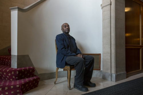 Doorman, Samuel Lee, of Detroit, poses for a photograph at the Detroit Towers located on E. Jefferson St. just east of downtown on Thursday, April 27, 2017 in Detroit. Lee has worked for 24 years at the Detroit Towers, first as a valet and now as one of the main doormen.