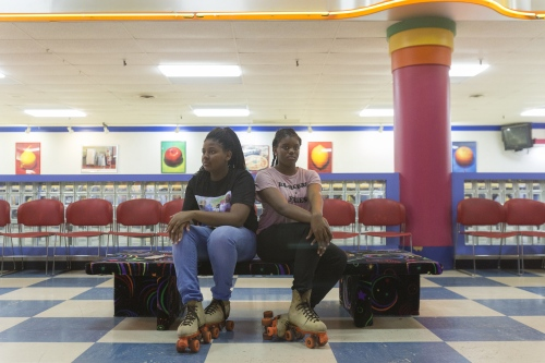 Jada Rankin's cousin, left, and a friend, pose for a portrait after lacing up their skates at the 16th birthday party Jada Rankin will never have. Money raised from the event went to her Crime Stopper's word in hopes to find her killer. 15-year-old Jada Rankin was shot and killed by a man driving by her grandmother's house during a family member's birthday celebration.