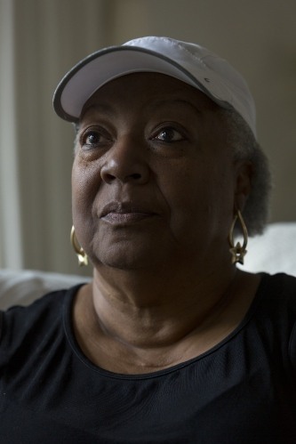 Janice Wells poses for a portrait in her living room on Friday, May 19, 2017 in the Crary St. Mary neighborhood in Detroit, Mich.