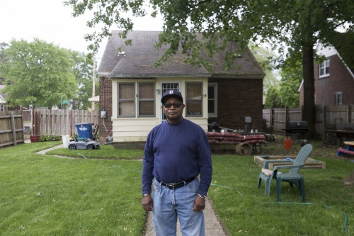 Carl Baxter poses for a portrait in the backyard of his home on Friday, May 19, 2017 in the Crary St. Mary neighborhood in Detroit.
