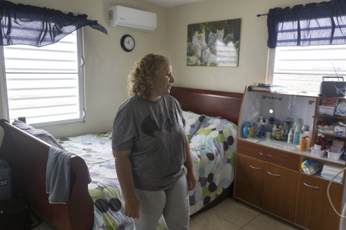 """It's fine if I don't eat,"" Zaida said. ""But what about my son?"" Zaida Lopez takes a moment while in her 18-year-old son Javier's bedroom in Barranquitas, Puerto Rico a couple weeks after Hurrican Maria ripped through the island. Javier suffers from a severe case of Smith-Lemli-Opitz syndrome, and after Hurricane Maria, the family has been struggling to keep him alive. Javier needs oxygen and a feeding tube to survive and because of the lack of power, the family barely makes it day to day by using an unreliable generator."