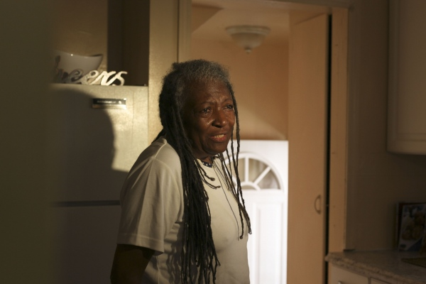 Lifelong Detroit resident Margaret Terry, 72, and Steve Wonder's first piano teacher, cries with joy while touring her and her brother's new home in Warrendale, Mich.