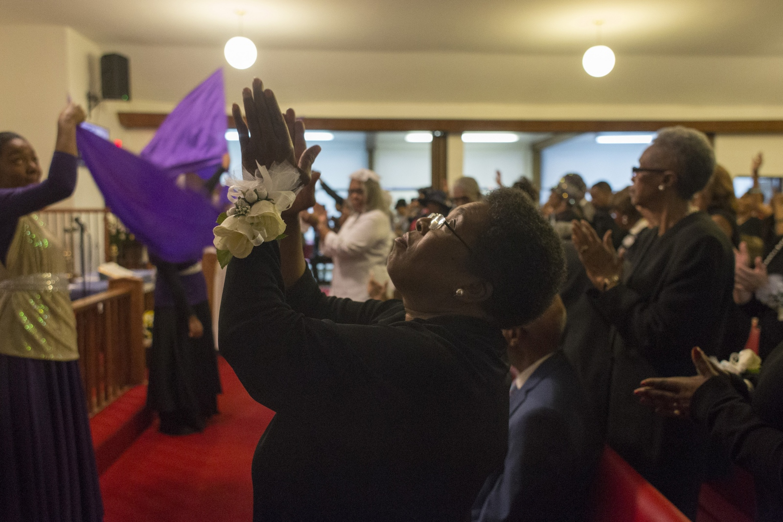 St. Paul African Methodist Episcopal or AME choir director Debra Williams, of Detroit, sends up praise during the church's dedication service in their new location in Grosse Pointe Park, Mich.