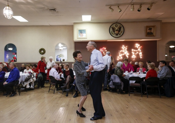 """The present generation is missing this,"" said Gus Zielinski, dancing with his wife of 56 years, Gerry Zielinski, both of Warren, during the Polka Booster Club of America's Christmas dance at the Lyskawaw VFW Hall in Dearborn Heights, Mich."