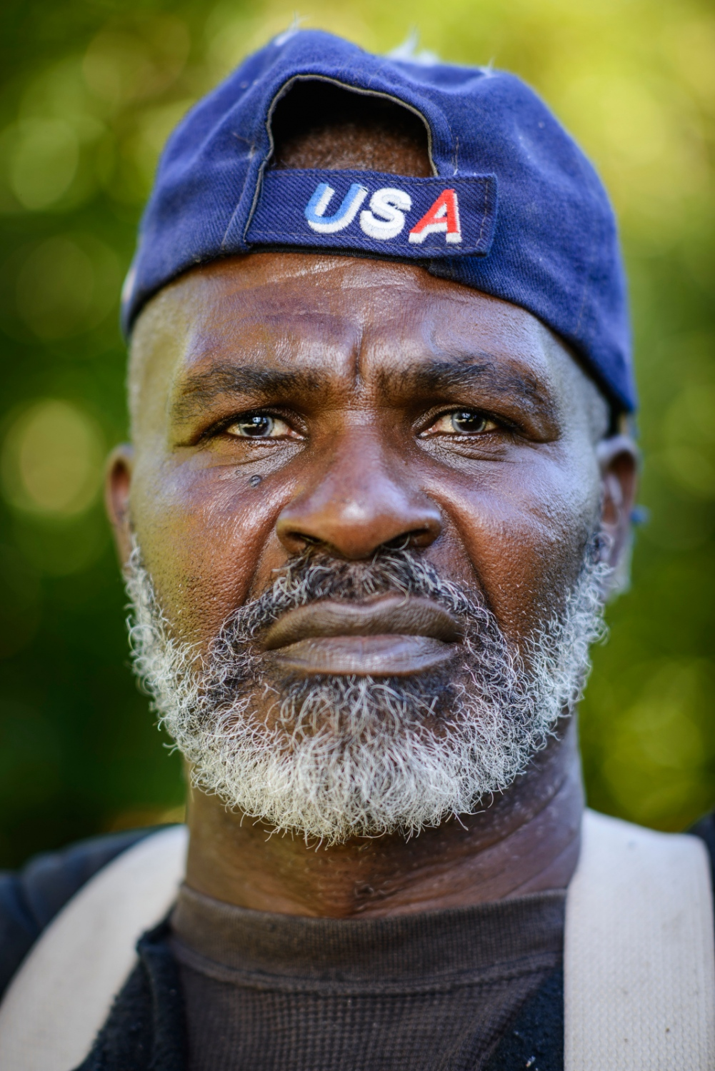 "A Jamaican apple picker nicknamed ""Fire"" at Sunrise Orchards, Cornwall, Vermont."