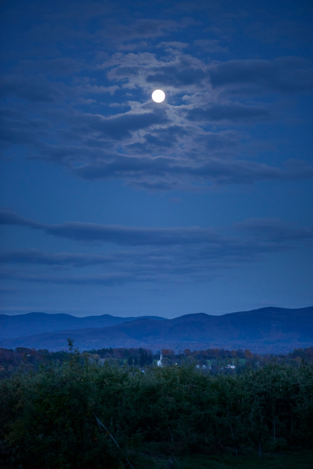 Full moon over the valley, looking east from Sunrise Orchards, Cornwall, Vermont.