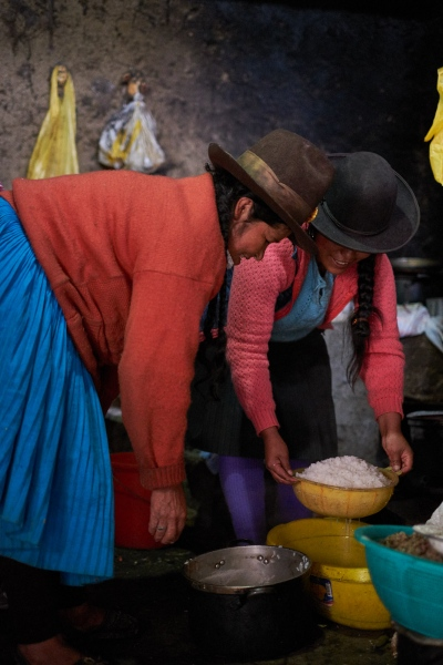 Women cooking breakfast, Chocquecancha, Peru.