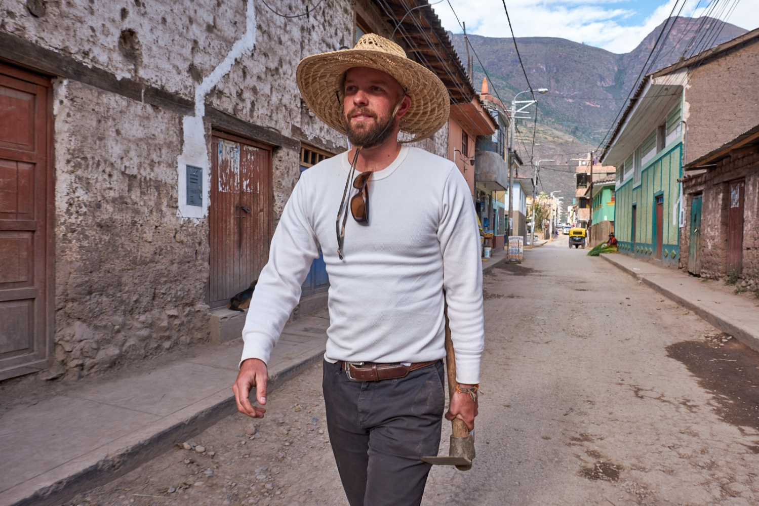 Aaron Ebner, co-founder of the Andes Alliance for Sustainable Development, walking from downtown Calca into the hills above the town where he maintains an organic garden plot.