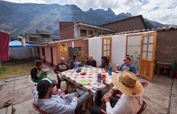 Staff and volunteers of the Andes Alliance for Sustainable Development (AASD) enjoy a view of the Urubamba Mountain during a lunch break in the backyard of their offices in Calca, Peru.