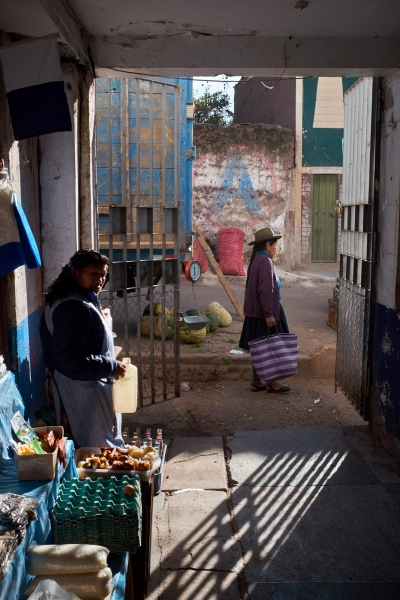 Shopper and shopkeeper at the Mercado de Calca, Peru.