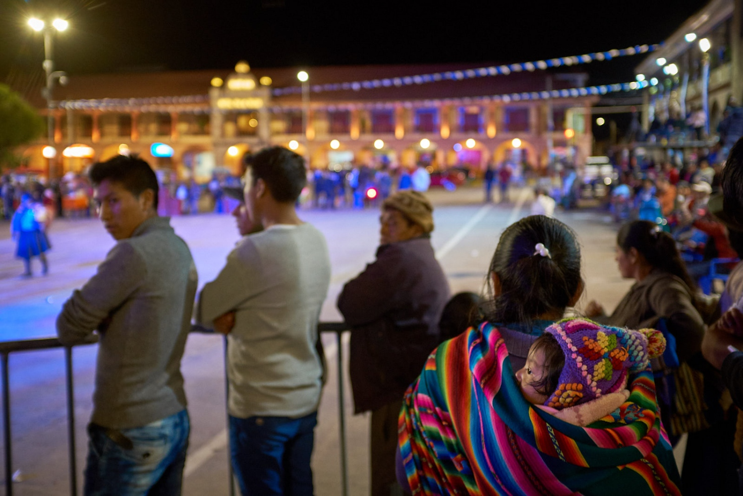 Mother and child during a town festival, Plaza de Armas, Calca, Peru.