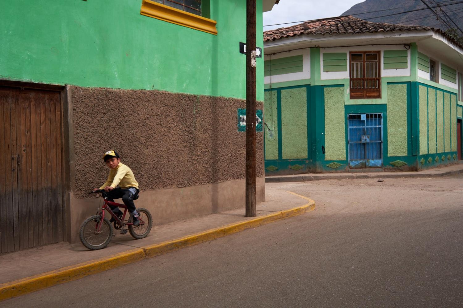 Boy on a bicycle, Calca, Peru.