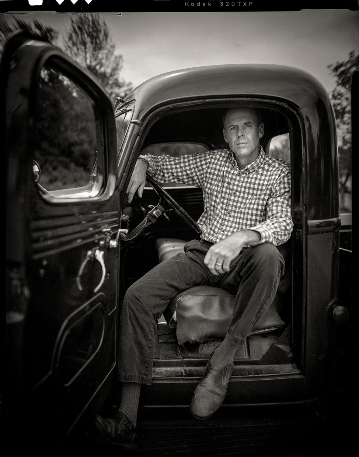 Boat builder Douglas Brooks with his 1947 International pickup truck, Vergennes, Vermont.