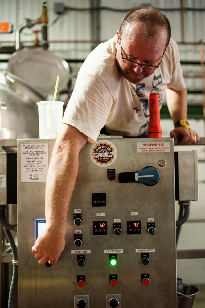Steve Parkes adjusting a control panel at the Drop-In Brewing Company, Middlebury, Vermont.