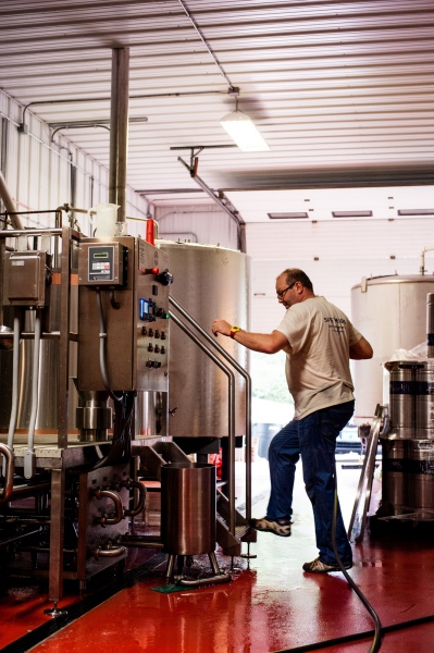 Steve Parkes of the Drop-In Brewing Company works on a fresh batch of beer, Middlebury, Vermont.