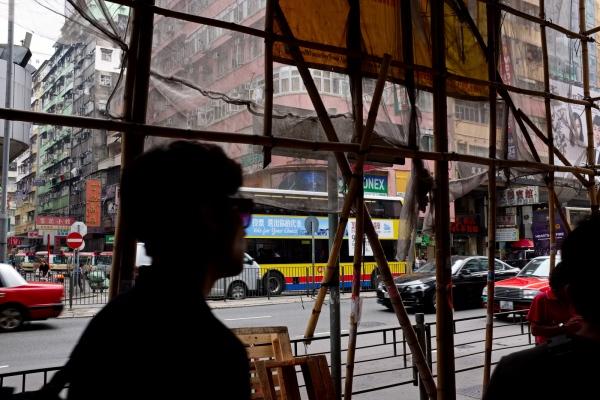 Bamboo scaffolding and pedestrians, Argyle Street, Kowloon, Hong Kong.