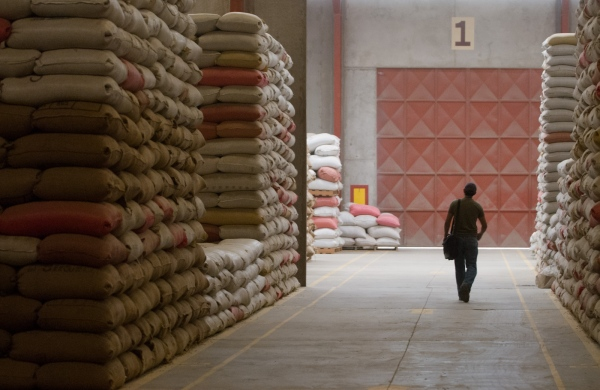 Stacks of bagged coffee await processing and delivery at the Beneficio Palín dry coffee mill in Guatemala.