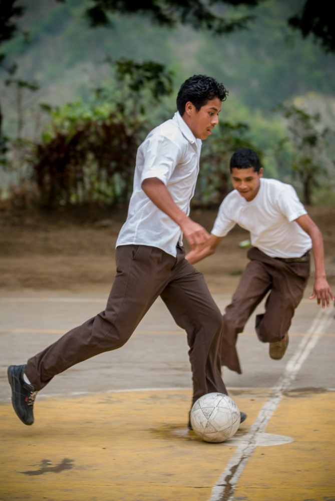 School boys playing soccer at the school run by Finca Dos Marias, San Marcos, Guatemala.