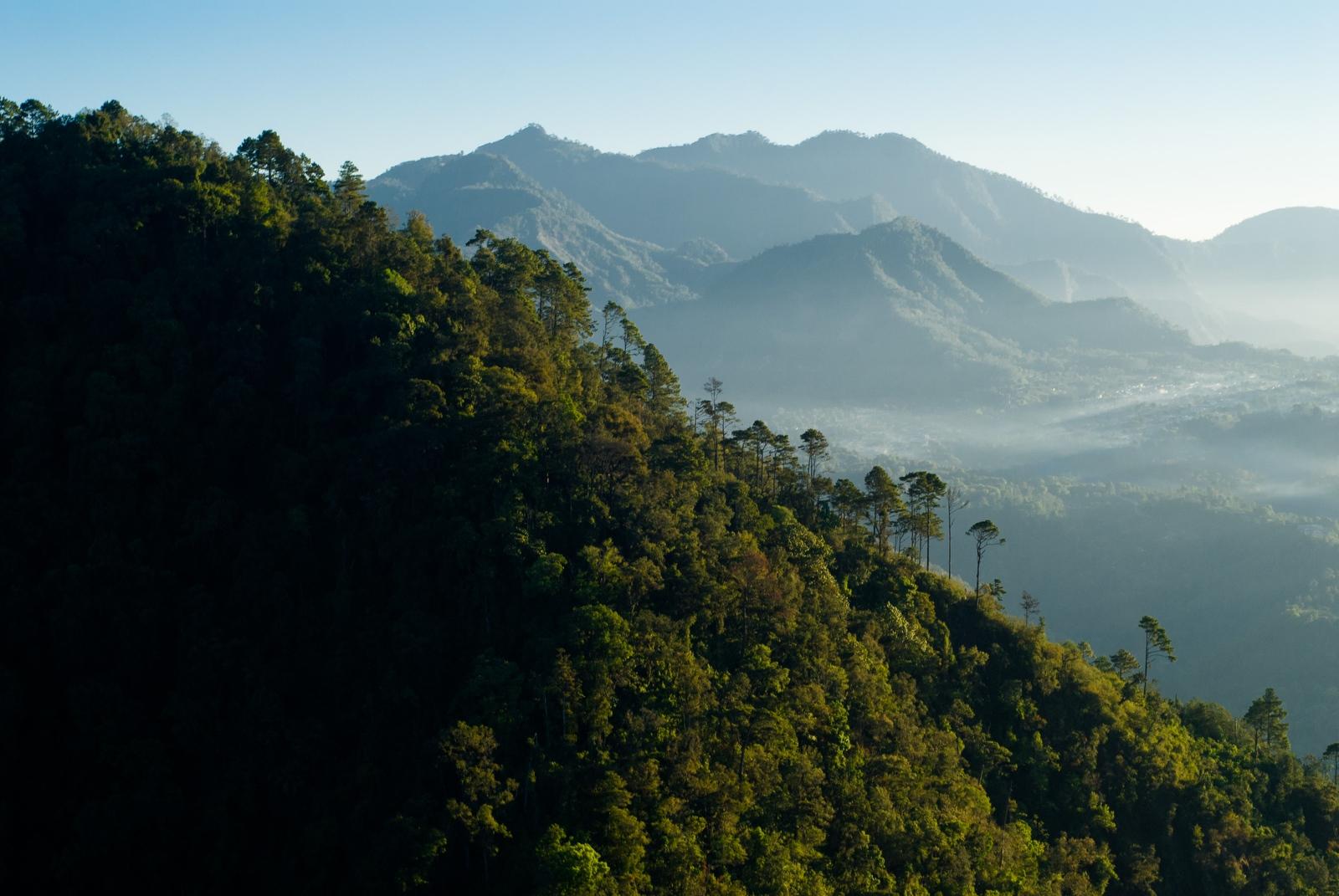 Morning mist shrouds the ridges of mountains surrounding Lake Atitlán, Guatemala.