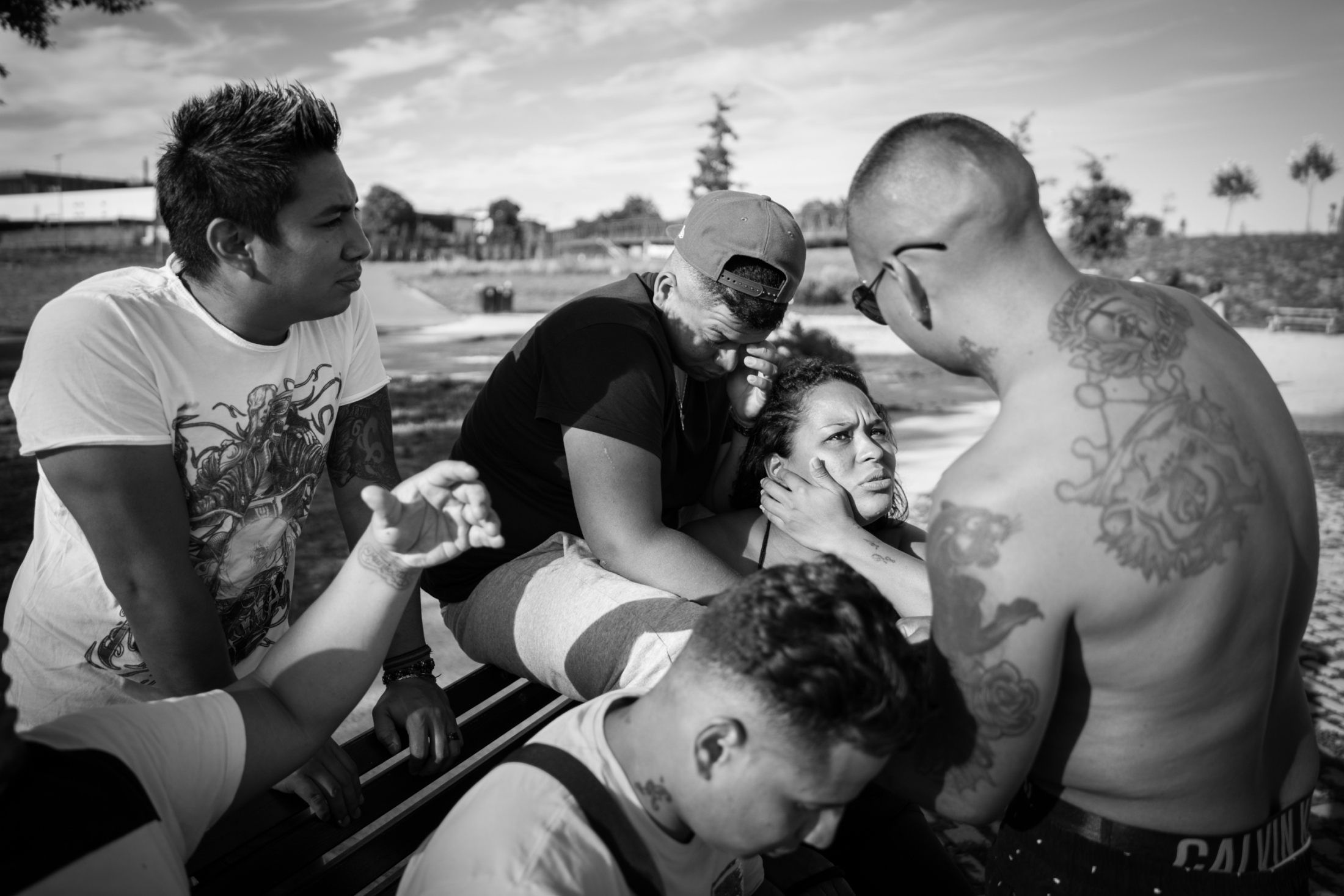 Latin Kings gather at a park during an important monthly meeting called Reunion del Sol (Meeting of the Sun), during the meeting they discuss new charges and missions they have to accomplish during the month, once the meeting is over they share food and drinks.