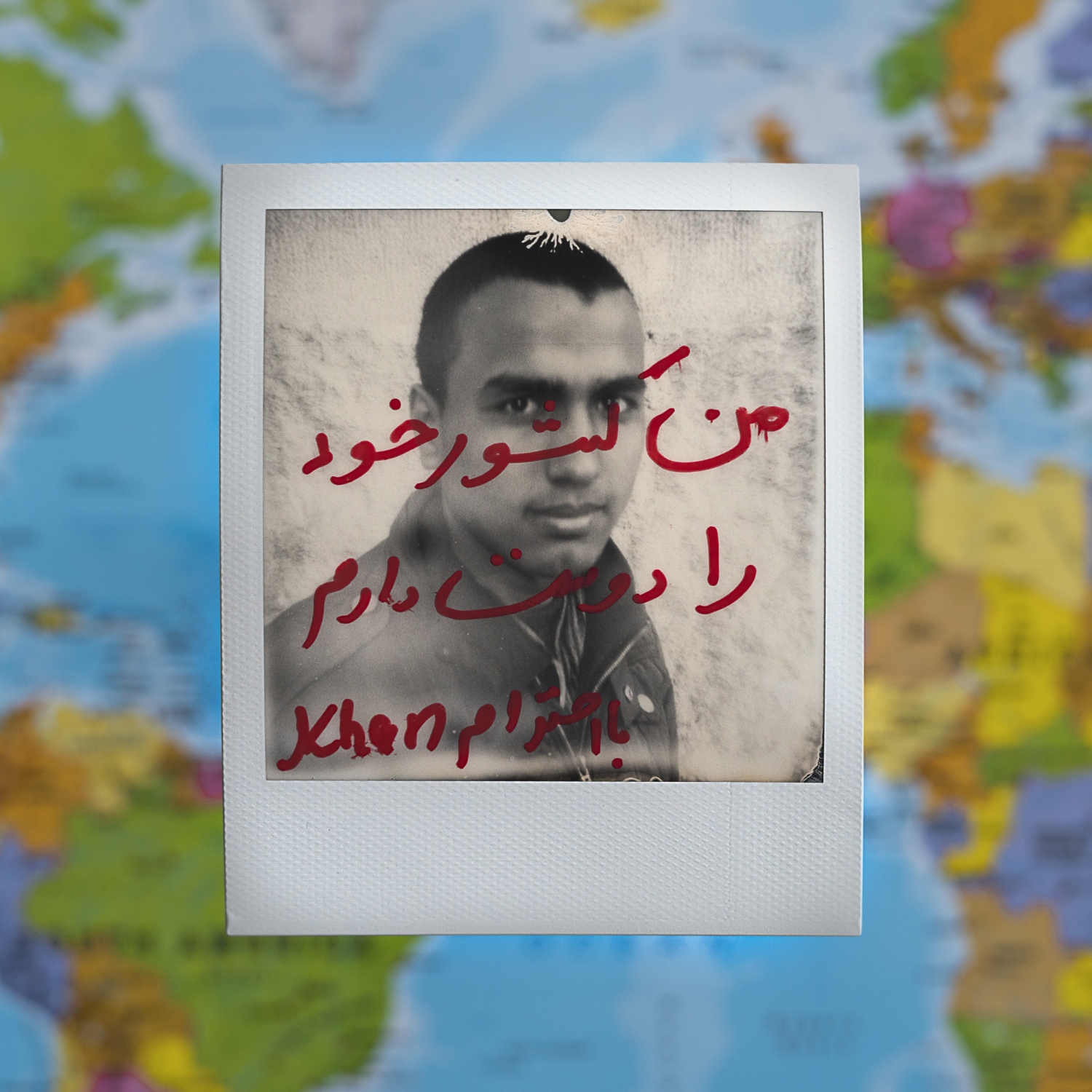"Khan/Afghanistan/14 years old/ Kahn's father was killed by Taliban in 2014. his mother saved money to help her son escape from the armed conflict in Afghanistan and start his journey to Europe. Kahn wrote on the picture ""I love my Country"" in Persian."