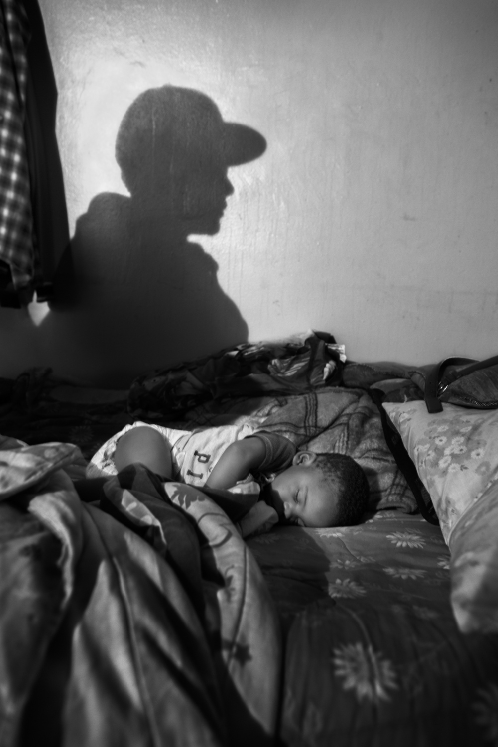 "Karen's baby, Kirell, sleeps at his home in the Bushwick projects, place that he shares with his uncle ""Smokey"" who rules this neighborhood for the Latin King Nation and wants Kirell to be part of the gang when he grows up."
