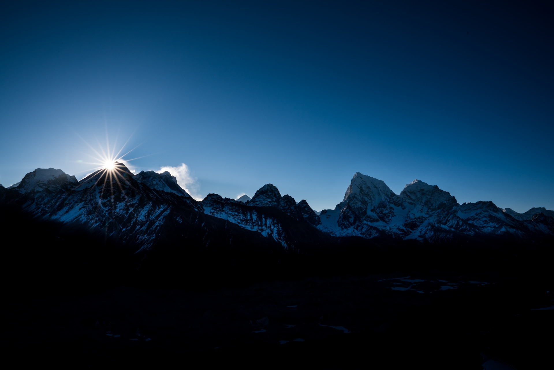 The sun rises behind Mt. Everest.