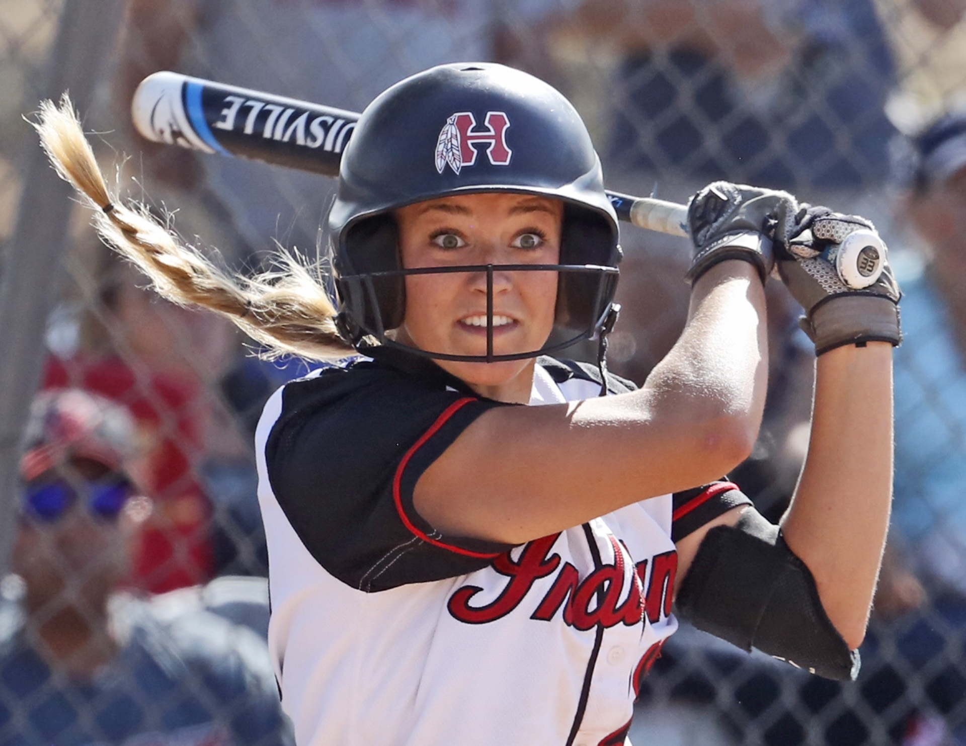 Hart's Abbey Sweet watches her basehit before heading for first base during a softball game. Katharine Lotze/The Signal