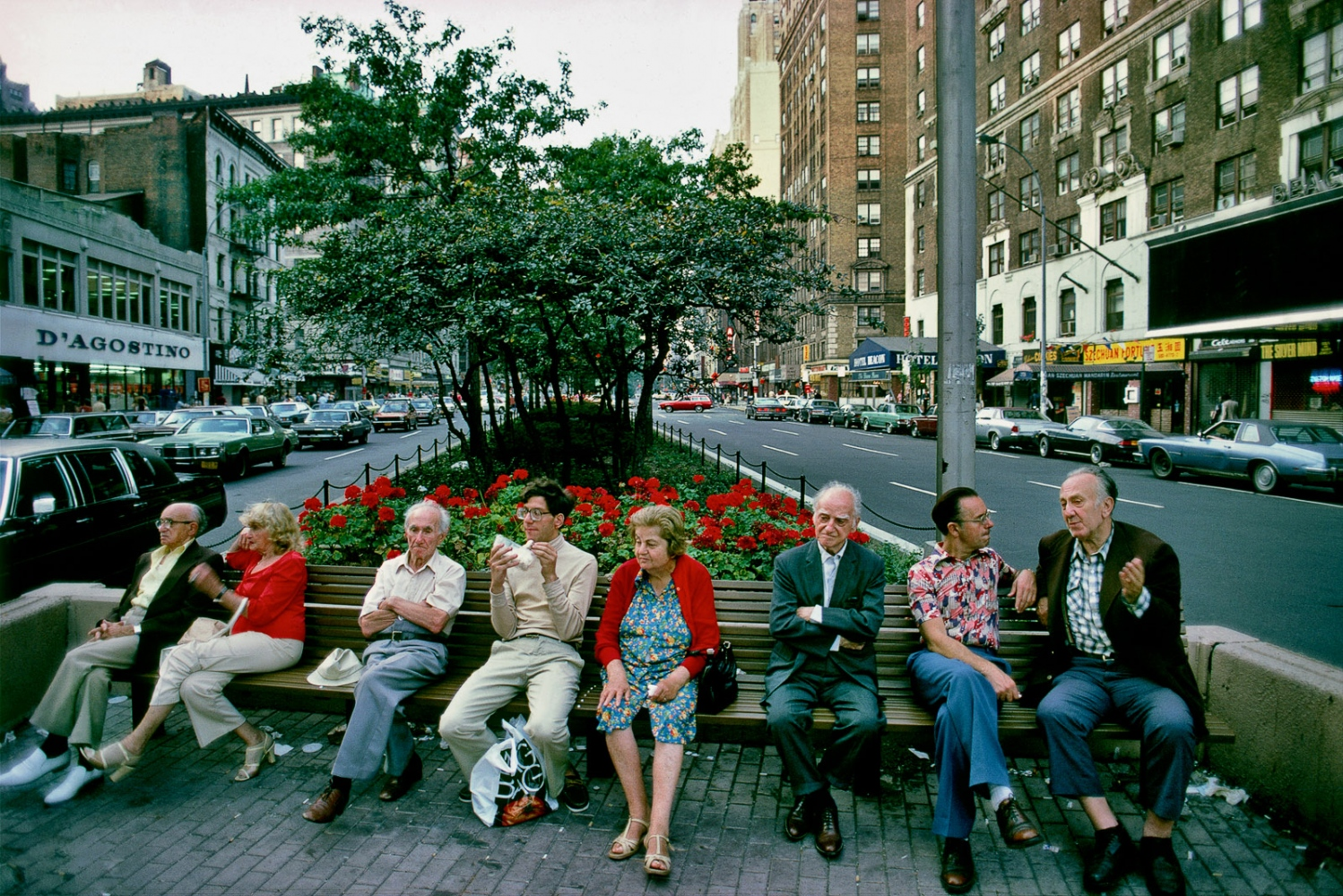 Folks chatting on bench on Amsterdam Ave.