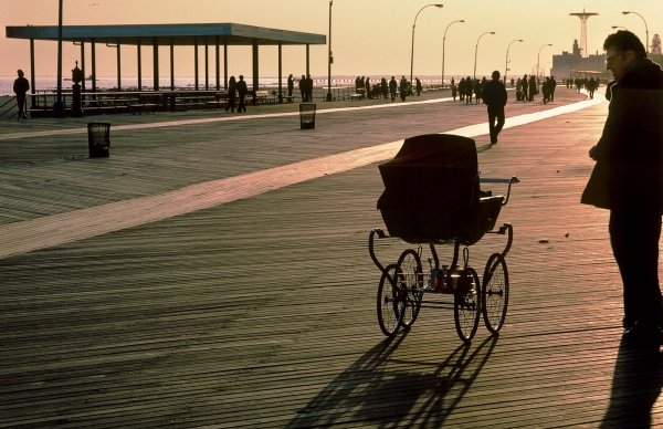 Coney Island boardwalk, man and pram