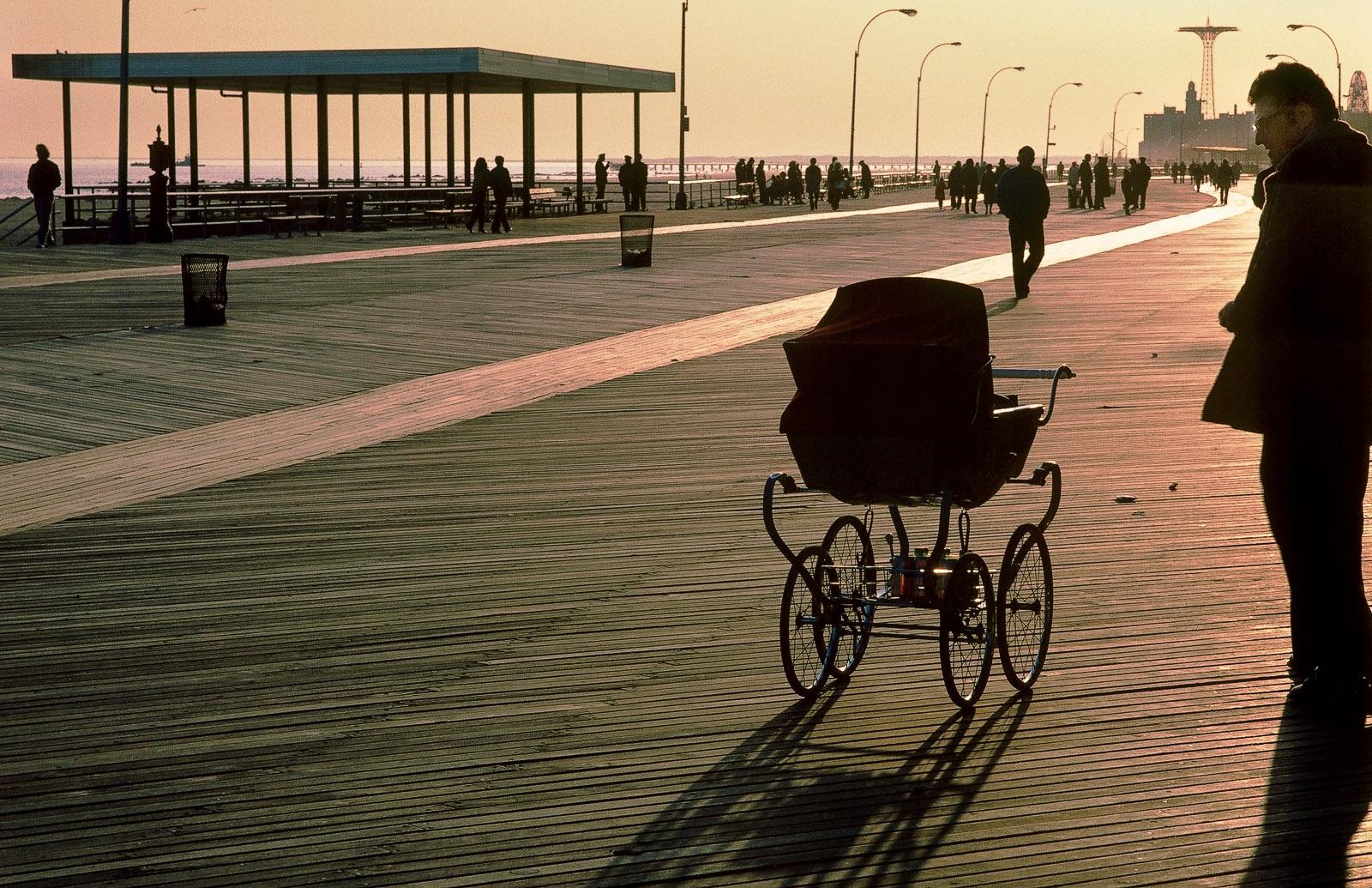 Coney Island boardwalk, man and pram