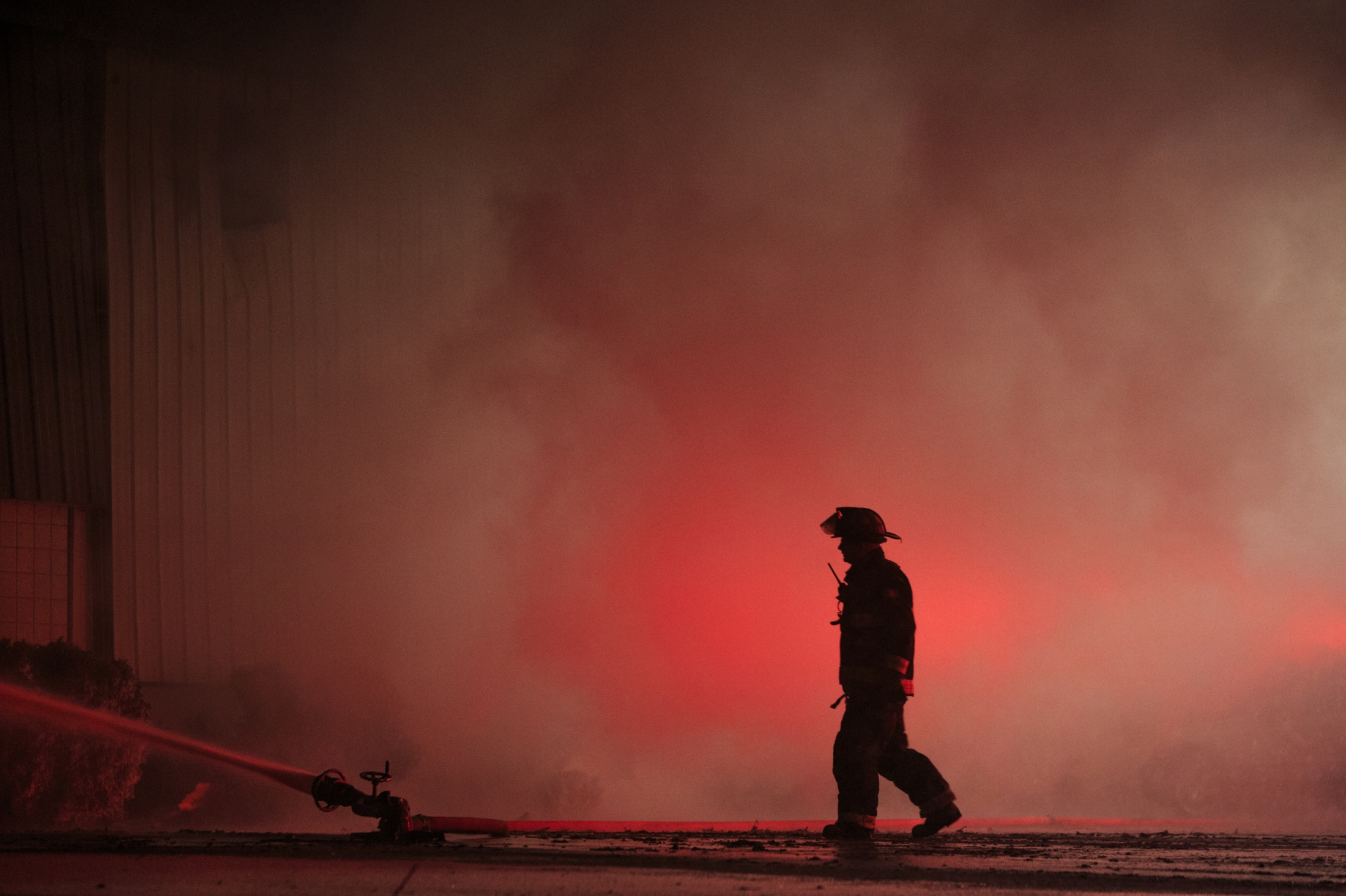 Multiple fire departments battle a large fire that broke out over night at Muskegon Casting Corporation at 2325 S. Sheridan Dr. in Muskegon on March, 15, 2017. Muskegon public safety director Jeffrey Lewis said an estimated 40 employees evacuated safely from the fire, which is believed to be caused by an equipment malfunction that created a spark to combustibles in the foundry, which is full of oils and metallurgic dust.