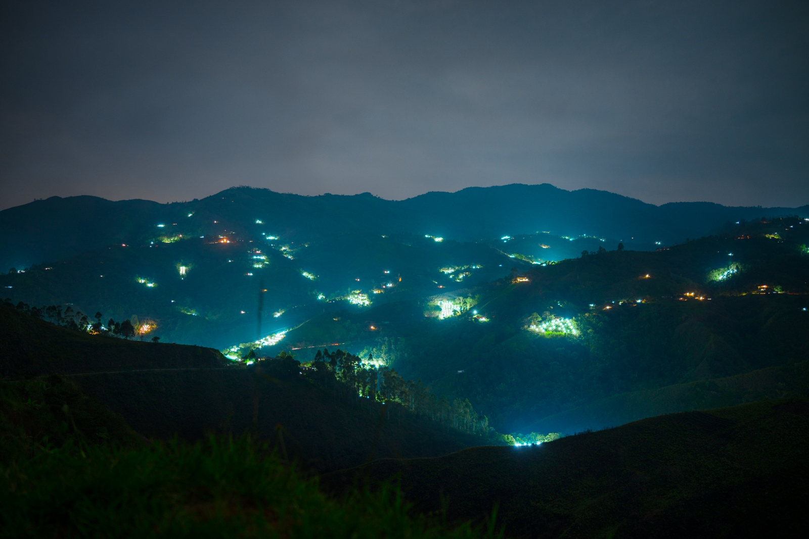 majority of lights in the image are illegal marijuana fields in the montains of Colombia, since marijuana needs constant light during the first 3 months of growth framers tend to steal the electricity from street poles by hooking pealed cables to them and powering their own plantations.