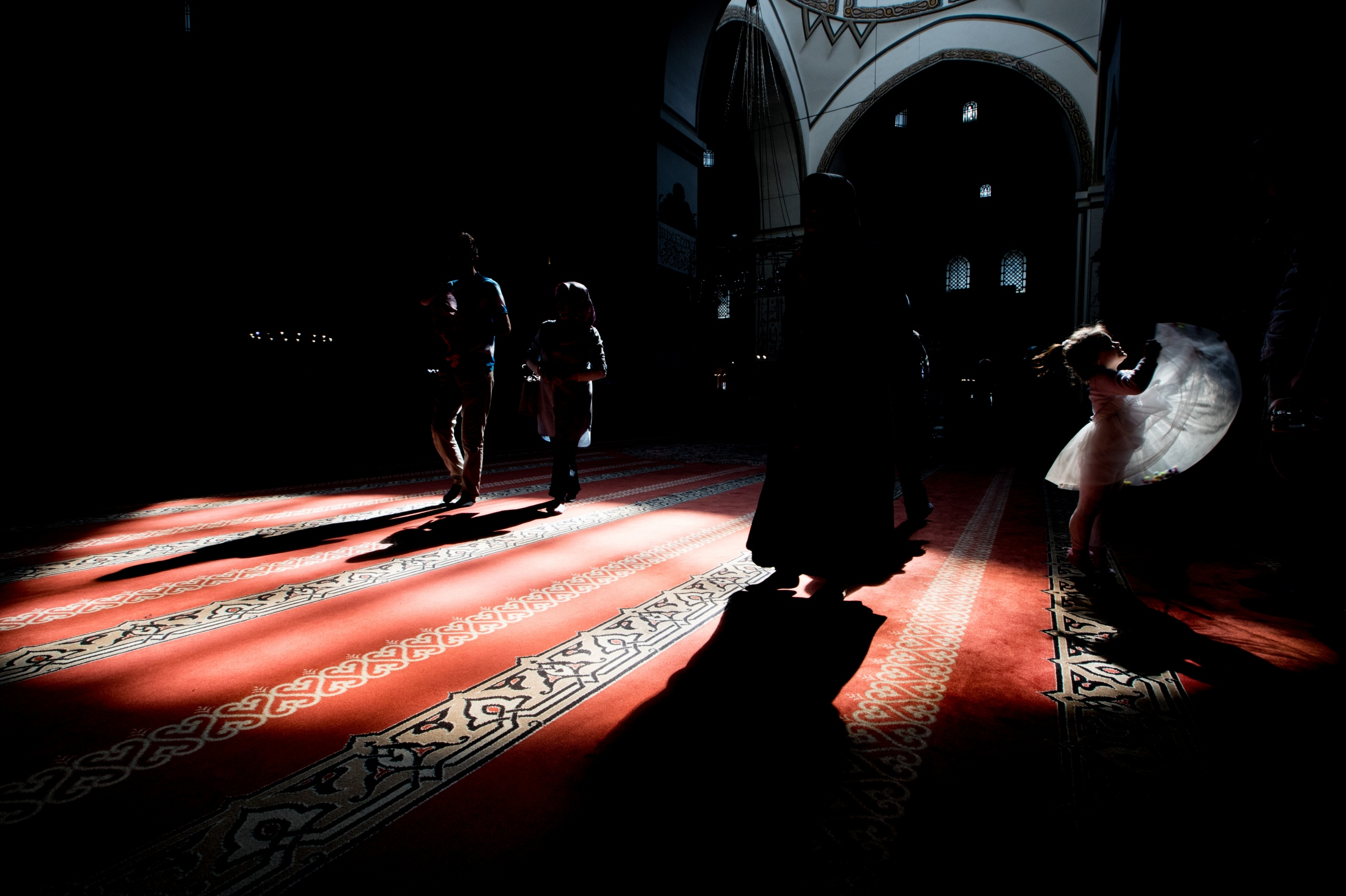 A little girl playing in the Grand Mosque in...