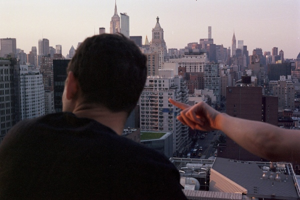 Griffin and Imogene over the skyline, New York, NY