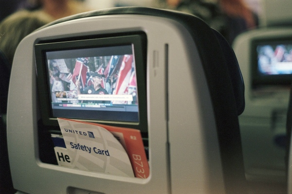 Charlottesville news on the plane, somewhere over America