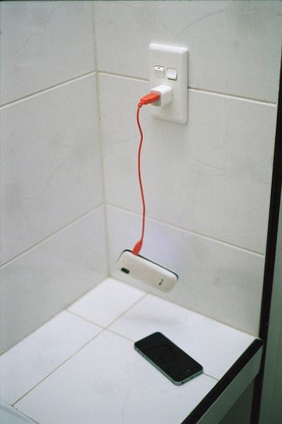 Charging Lisette's extra phone, Havana, Cuba