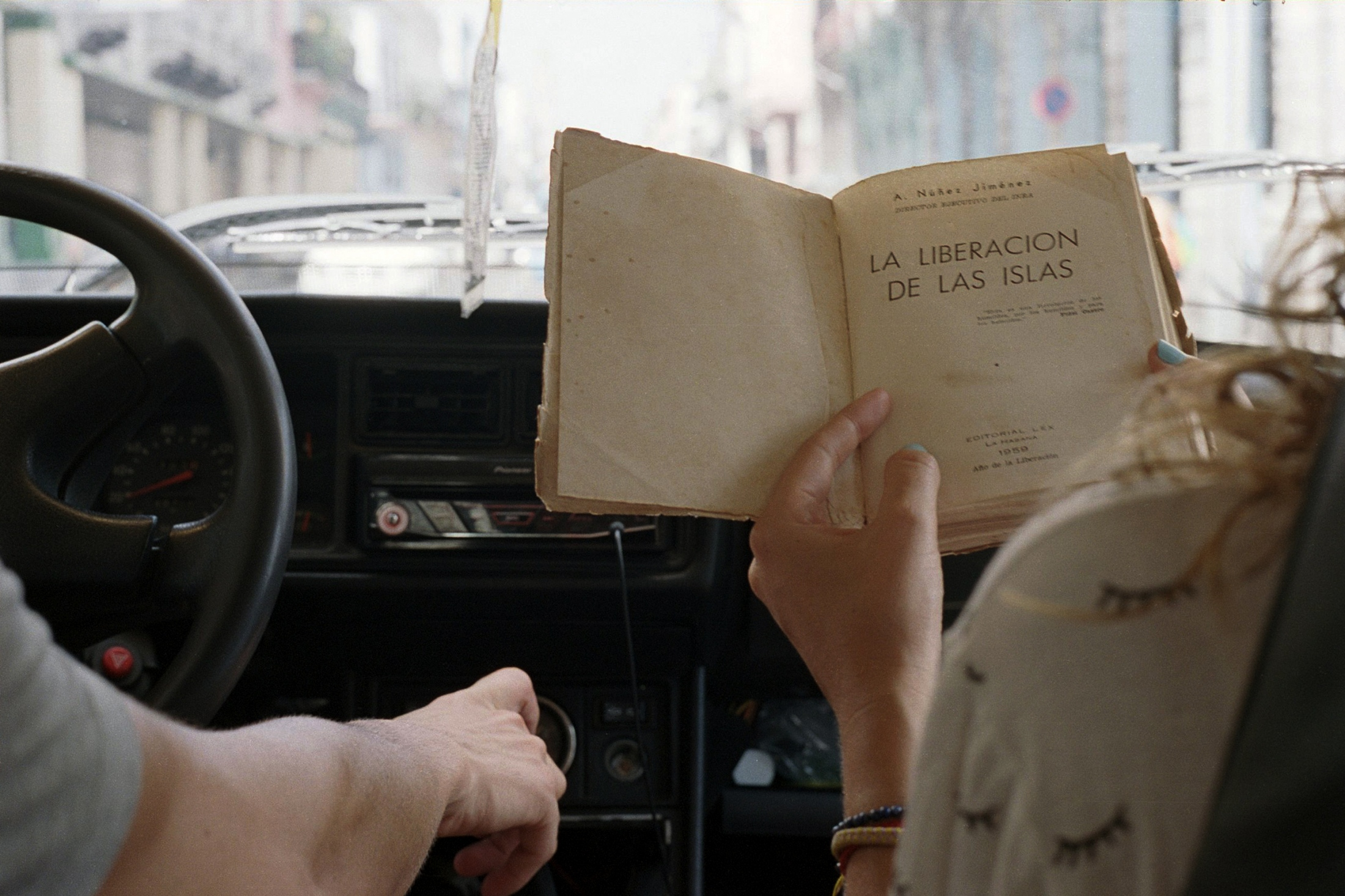 Lisette looking through the book I just bought, Havana, Cuba