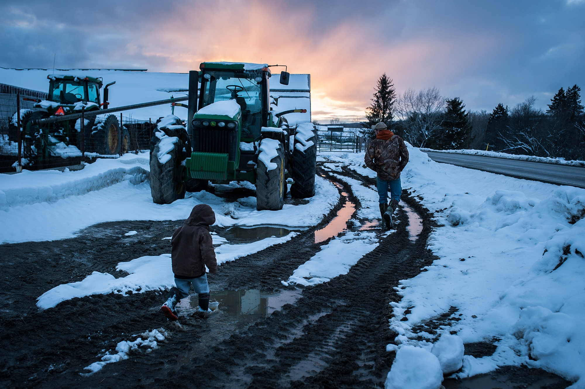 Fred Morgan's son, Cody Morgan, 23, and his nephew Tucker Bailey, 4, at their family's cow farm in Eaton, NY Thursday, March 8, 2018. Fred Morgan said he had considered committing suicide so that his family could receive a life insurance payout after he was unable to repay debts. Kholood Eid for The New York Times