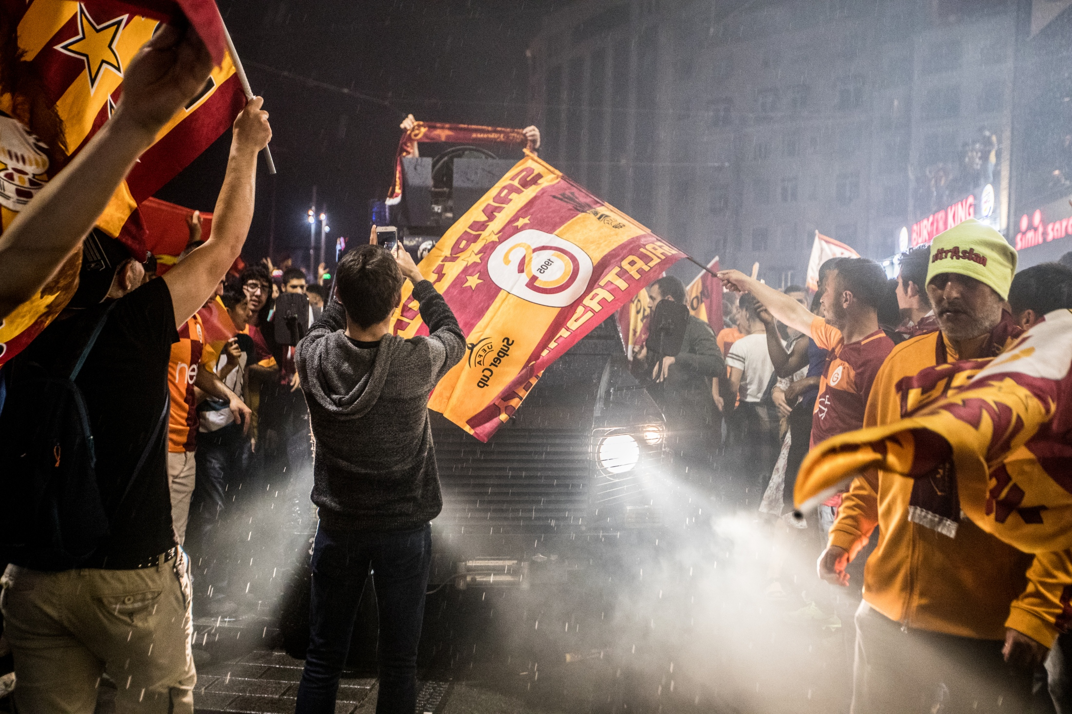 Galatasaray's supporters celebrate their...
