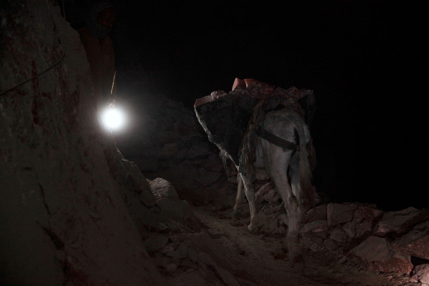 Throughout the night donkeys are still used at the remote Kalabagh salt mine. Reaching areas that tractors still can't get to, the donkeys carry the rock salt to areas that is then collected and taken out of the mine during the day by tractors.