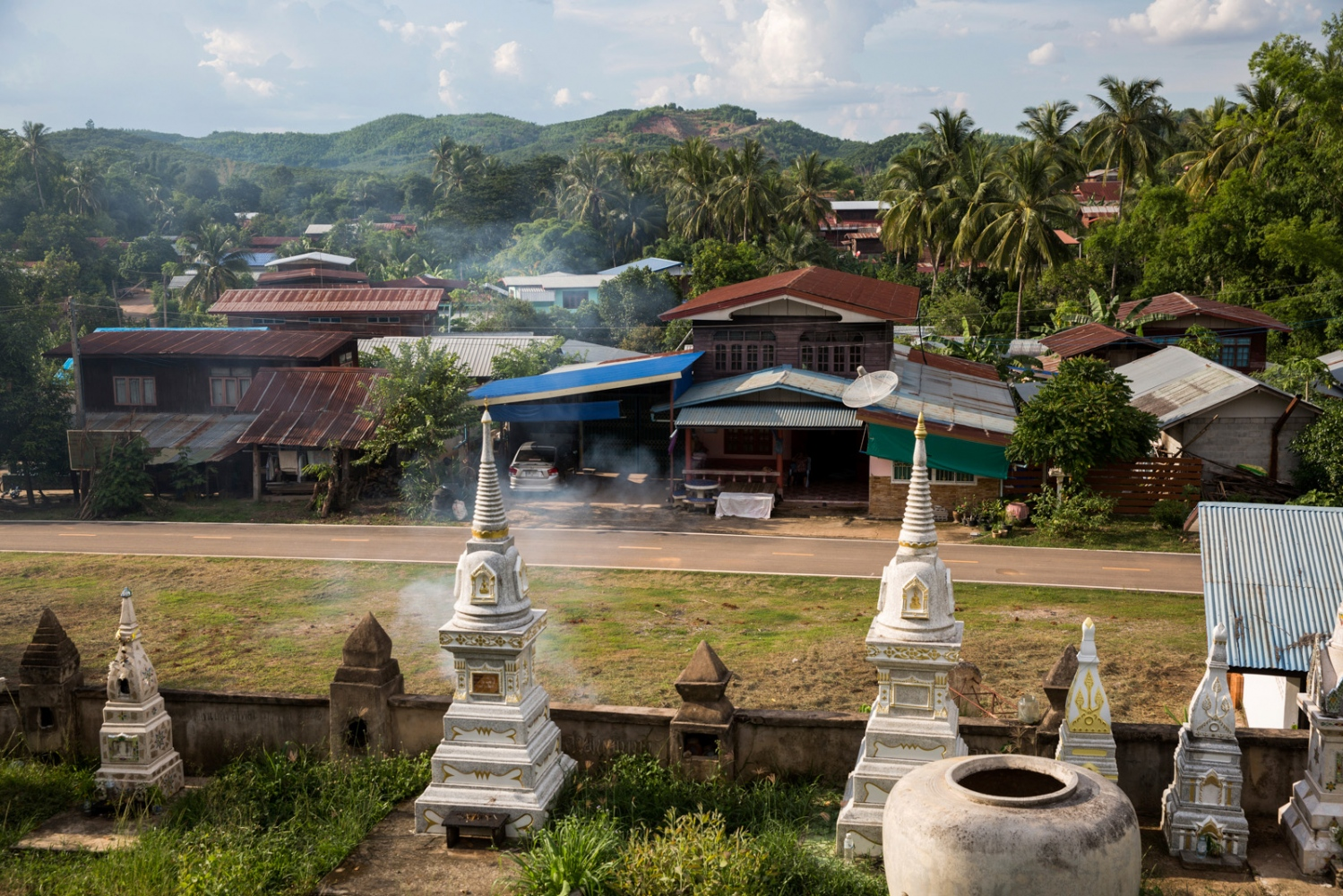 The village of Na Nong Bong viewed from the local Buddhist temple. One of the mines can be seen on the top of the hill in the distance.
